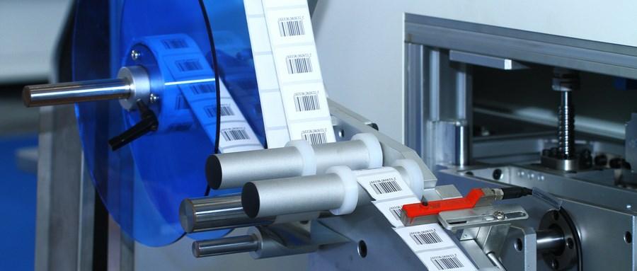 热熔胶贴标机与不干胶贴标机的区别